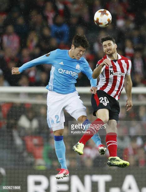Marseille defender Hiroshi Sakai challenges Aritz Aduriz of Athletic Bilbao in the air during their Europe League match on March 15 in Bilbao Spain...