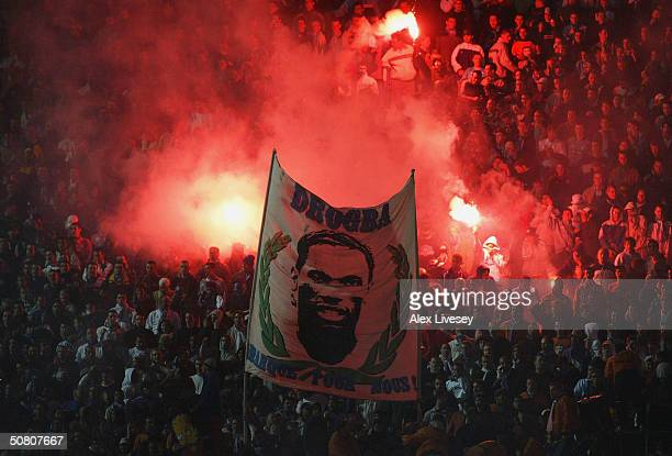Marseille fans celebrate with flares and wave a banner of Didier Drogba after he scores their first goal during the UEFA Cup Semi-Final, Second Leg...