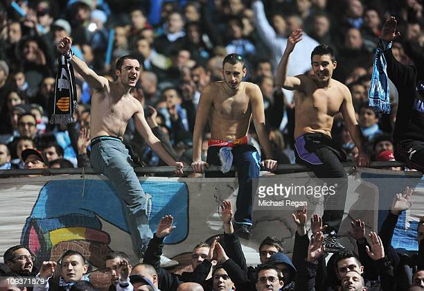 Marseille fans cheer during the UEFA Champions League round of 16 first leg match between Marseille and Manchester United at the Stade Velodrome on...