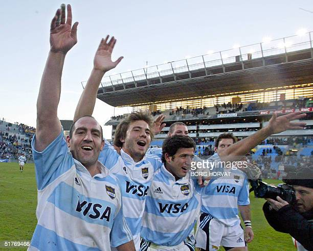 Argentina's players Mario Ledesma JuanMartin Hernandez and Herman Senillosa celebrate their team's victory at the end of the rugby union test France...