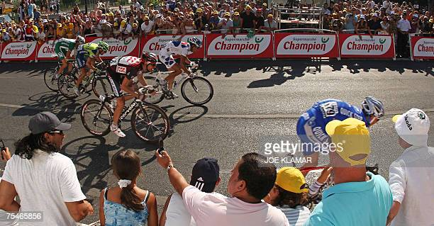 France?s Cedric Vasseur sprints towards the finish line as he is followed by France?s Sandy Casar , Germany's Jens Voigt , Switzerland?s Michael...