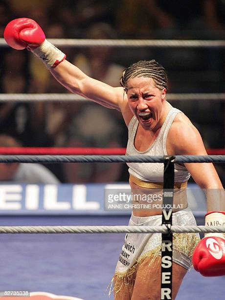 French boxer Myriam Lamare celebrates when she defeated Ukrainian Elena Tverkholev after the referee stopped their WBA super light weight title match...