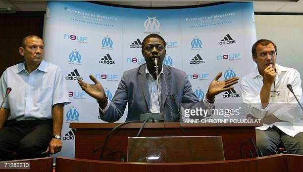 French football L1 club Olympique de Marseille's president Pape Diouf flanked by the new coach Albert Emon and the new deputy coach Dominique Cuperly...