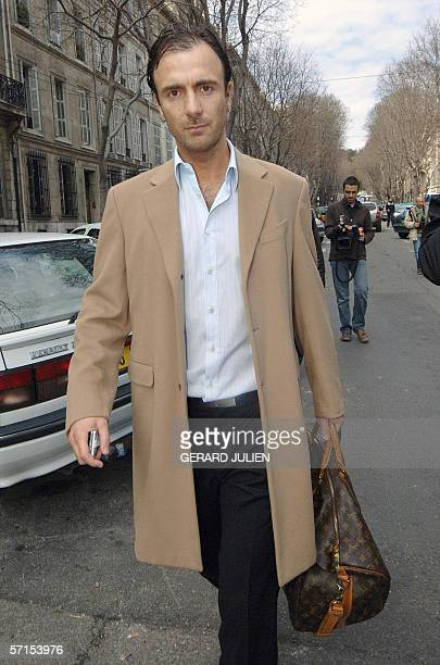 French former football player forward Christophe Dugarry leaves the court house of Marseille 22 March 2006 Dugarry was due to appear in court today...