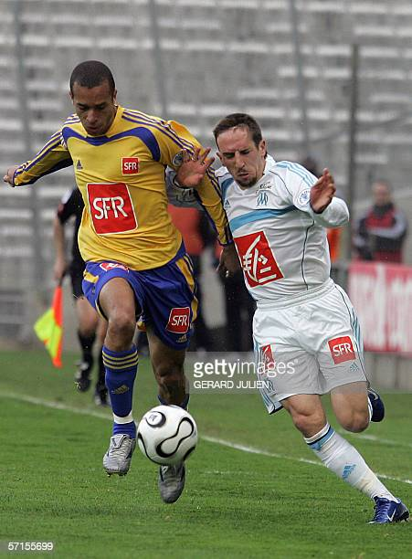 Marseille's French midfielder Franck Ribery vies with Sochaux's Brazilian defender Joao Miranda during the French Cup football match between...