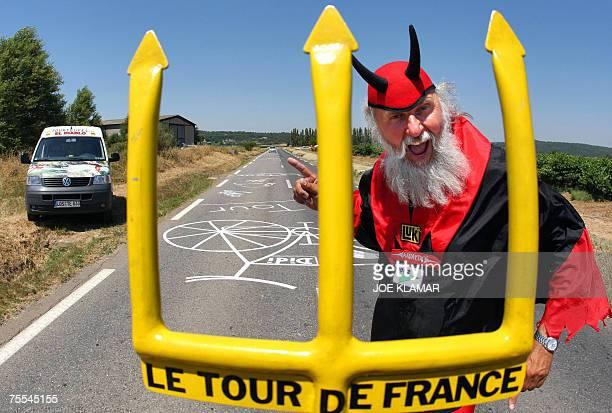 TO GO WITH AFP STORY EL DIABLO'S NAME IS DIETER SENFT German fan Dieter Senft known as El Diablo poses with his devil costume in SaintMaximin...
