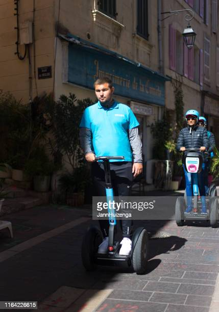 marseille, france: tourists on segways in old le panier district - downtown comedy duo stock pictures, royalty-free photos & images