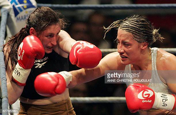 Ukrainian boxer Elena Tverkholev hits French Myriam Lamare during their WBA super light weight title match 29 April 2005 in Marseille Lamare won the...