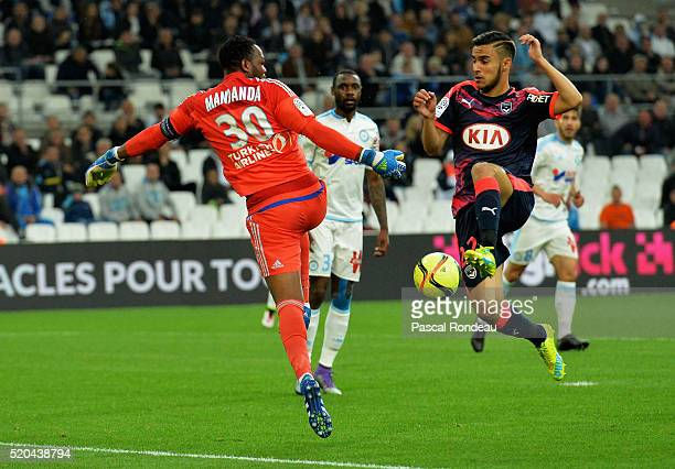 Marseille goalkeeper Steve Mandanda in front of Adam Ounas from Bordeaux during the French League 1 match between Olympique de Marseille and FC...