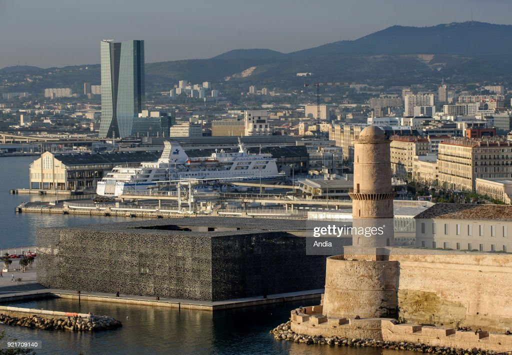 Marseille (south-eastern France). . Overview of Marseille Fos Port (French GPMM) at the bottom of the skyscraper 'tour CMA-CGM'. Combine ship (passengers - cargo) of the shipping company 'Algerie Ferries' alongside the quay.