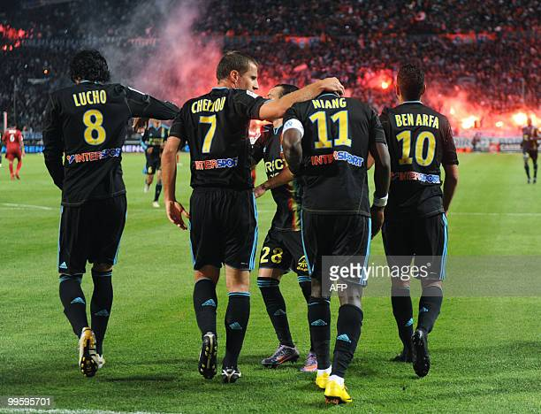 Marseille' striker Mamadou Niang is congratulated by teammates Lucho Benoît Cheyrou Mathieu Valbuena and Hatem Ben Arfa after scoring during the...
