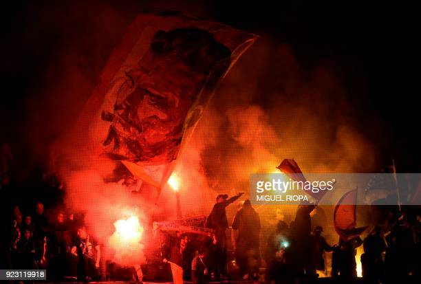 Marseille supporters light flares during the Europa League Round of 32 second leg football match between SC Braga and Olympique de Marseille at the...