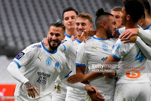 Marseille's Argentine forward Dario Benedetto celebrates with teammates after scoring a goal during the French L1 football match between Olympique de...