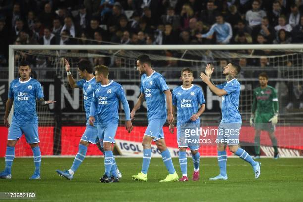 Marseille's Argentine forward Dario Benedetto celebrates with his teammates after scoring a goal during the French L1 football match between SC...