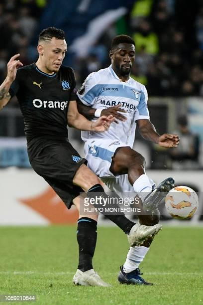 Marseille's Argentine midfielder Lucas Ocampos and Lazio's Angolan defender Bastos go go for the ball during the UEFA Europa League group H football...