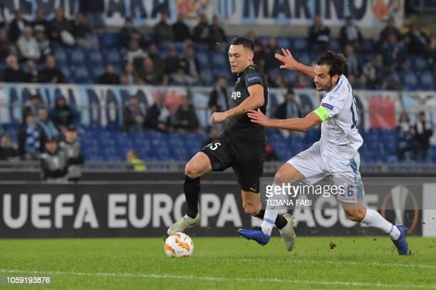 Marseille's Argentine midfielder Lucas Ocampos outruns Lazio's Italian midfielder Marco Parolo during the UEFA Europa League group H football match...
