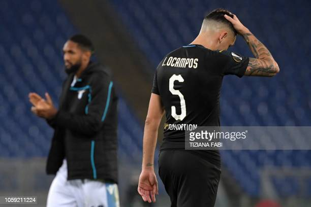 Marseille's Argentine midfielder Lucas Ocampos reacts next to Lazio's Brazilian defender Wallace at the end of the UEFA Europa League group H...
