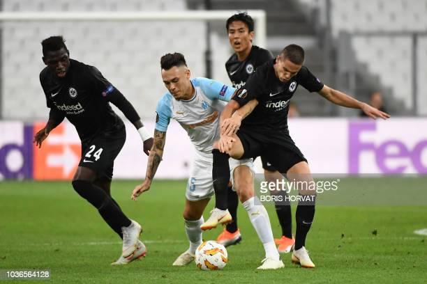 Marseille's Argentine midfielder Lucas Ocampos vies for the ball with Frankfurt's German defender Danny da Costa and Frankfurt's Serbian midfielder...