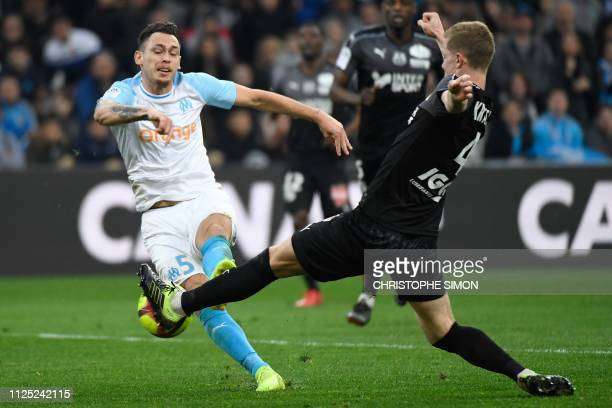 Marseille's Argentine midfielder Lucas Ocampos vies with Amien's Swedish defender Emil Krafth during the French L1 football match Olympique de...