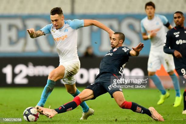Marseille's Argentine midfielder Lucas Ocampos vies with Dijon's Moroccan defender Fouad Chafik during their French football L1 match Olympique de...