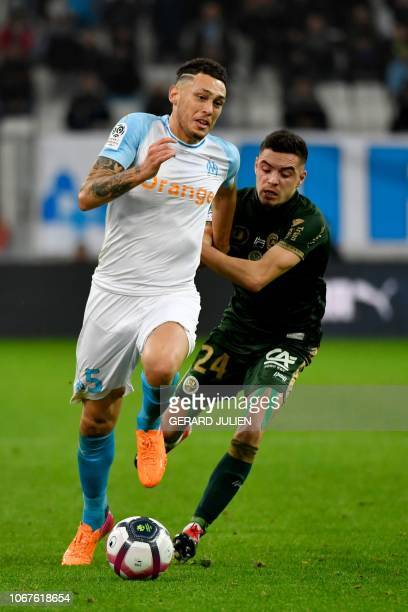 Marseille's Argentine midfielder Lucas Ocampos vies with Reims' French midfielder Mathieu Cafaro during the French L1 football match between...