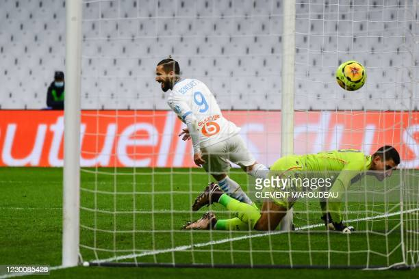 Marseille's Argentinian forward Dario Benedetto reacts after scoring during the French L1 football match between Olympique de Marseille and AS Monaco...