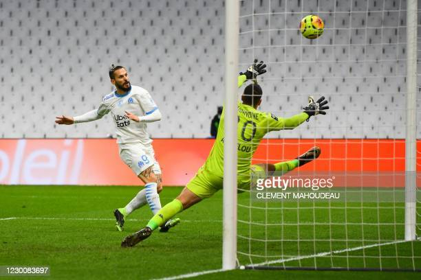 Marseille's Argentinian forward Dario Benedetto shoots and score a goal during the French L1 football match between Olympique de Marseille and AS...