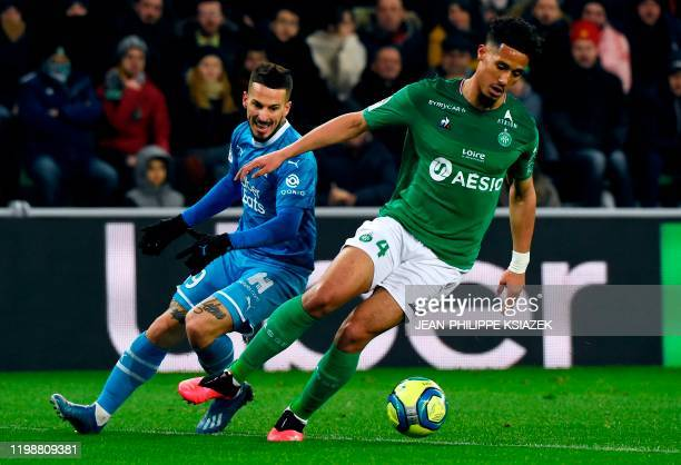 Marseille's Argentinian forward Dario Benedetto vies for the ball with Saint-Etienne's French defender William Saliba during the French L1 football...