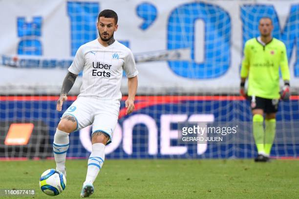 Marseille's Argentinian forward Dario Ismael Benedetto controls a ball during the French L1 football match between Olympique de Marseille and Stade...