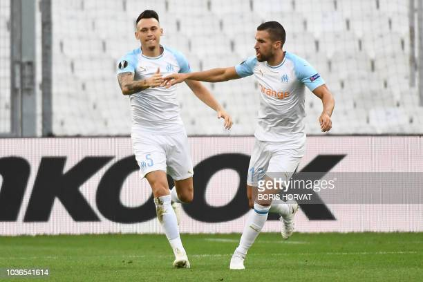 Frankfurt's Serbian forward Luka Jovic celebrates with teammates after scoring during the Europa League Group E football match between Olympique de...