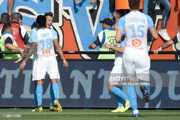 Marseille's Argentinian forward Lucas Ocampos celebrates with Marseille's French defender Jordan Amavi after scoring a goal during the French L1...