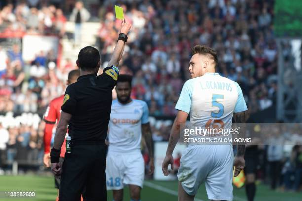 Marseille's Argentinian forward Lucas Ocampos receives a yellow card during the French L1 football match between Guingamp and Olympique de Marseille...