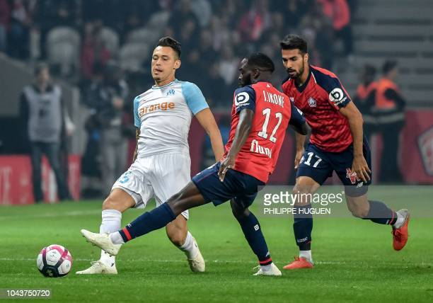 Marseille's Argentinian forward Lucas Ocampos vies with Lille's French midfielder Jonathan Bamba during the French L1 football match between Lille...