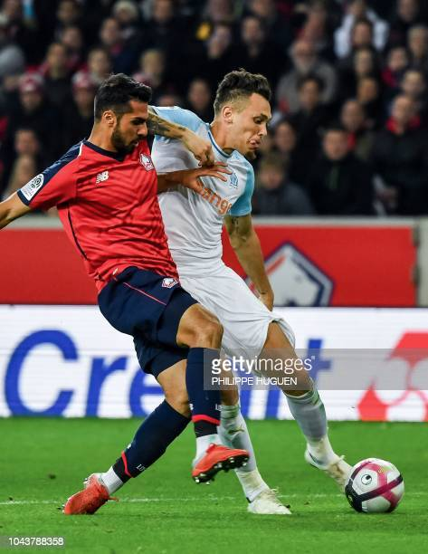 Marseille's Argentinian forward Lucas Ocampos vies with Lille's Turkish defender Mehmet Zeki Celik during the French L1 football match between Lille...