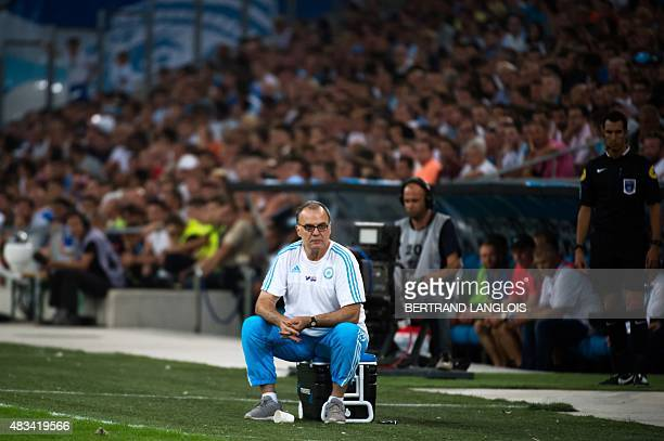 Marseille's Argentinian head coach Marcelo Bielsa looks on during the French L1 football match between Olympique de Marseille and Stade Malherbe de...