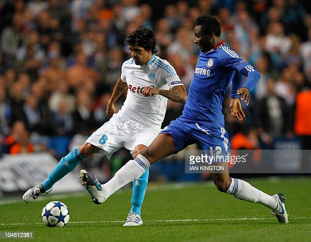 Marseille's Argentinian player Lucho Gonzalez vies with Chelsea's Nigerian footballer John Obi Mikel during their Group F UEFA Champions League...