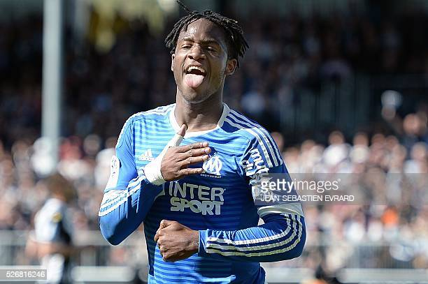 Marseille's Belgian forward Michy Batshuayi celebrates after scoring during the French L1 football match between Angers and Marseille on May 1 2016...