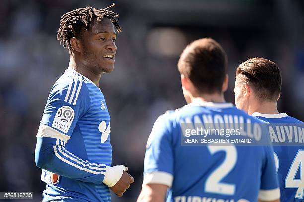 Marseille's Belgian forward Michy Batshuayi celebrates with his teammates after scoring during the French L1 football match between Angers and...