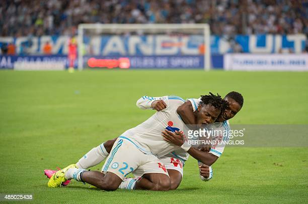 Marseille's Belgian forward Michy Batshuayi is congratulated by Marseille's Guinean midfielder Bouna Sarr after scoring a goal during the French L1...