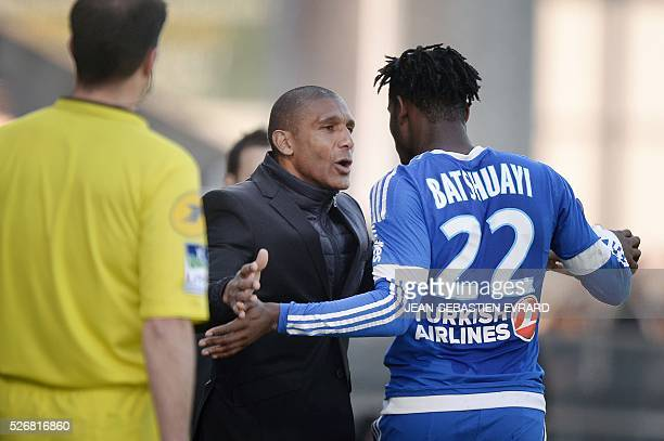 Marseille's Belgian forward Michy Batshuayi is congratulated by Marseille's French assistant coach Franck Passi during the French L1 football match...