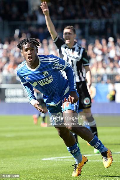 Marseille's Belgian forward Michy Batshuayi reacts after scoring during the French L1 football match between Angers and Marseille on May 1 2016 at...