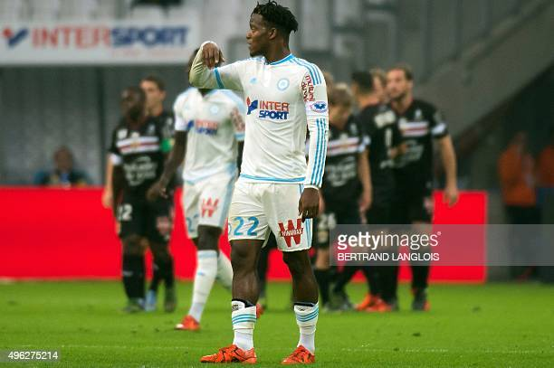 Marseille's Belgian forward Michy Batshuayi reacts as Nice's teammates celebrate after scoring during the French L1 football match Olympique de...