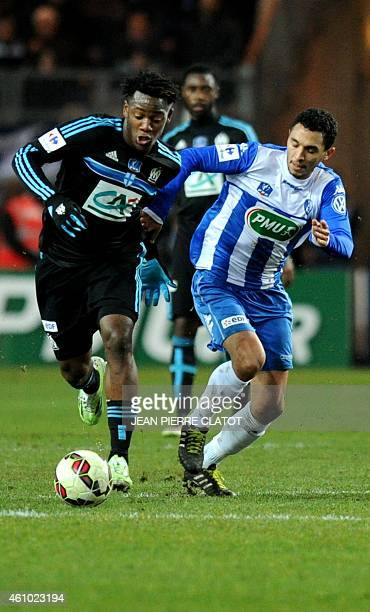 Marseille's Belgian midfielder Michy Batshuayi vies with Grenoble's French midfielder Hamadi Ayari during the French Cup round of 32 football match...
