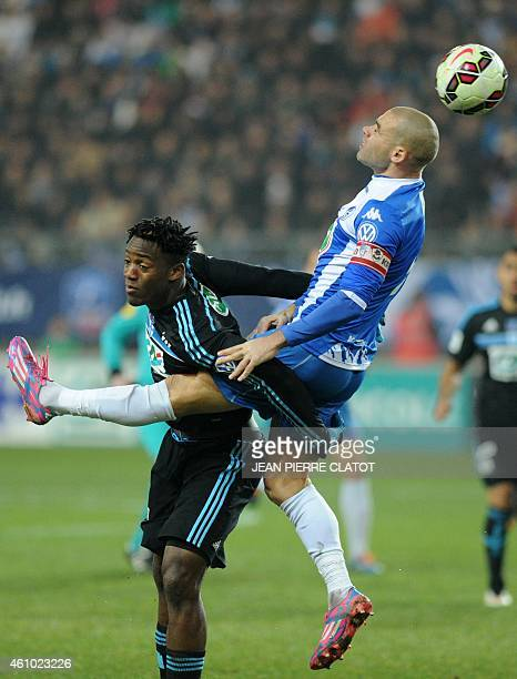 Marseille's Belgian midfielder Michy Batshuayi vies with Grenoble's French defender Selim Bengriba during the French Cup round of 32 football match...