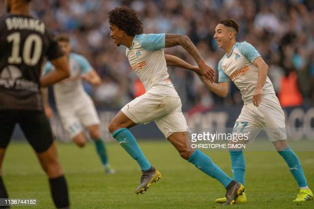 Marseille's Brazilian midfielder Luiz Gustavo celebrates with Marseille's French midfielder Maxime Lopez after scoring a goal during the French l1...