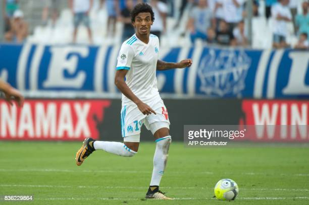 Marseille's Brazilian midfielder Luiz Gustavo Dias runs with the ball during the French L1 football match Olympique de Marseille vs Angers on August...