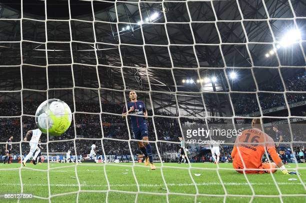 Marseille's Brazilian midfielder Luiz Gustavo reacts after scoring a goal past Paris SaintGermain's French goalkeeper Alphonse Areola during the...