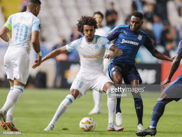 Marseille's Brazilian midfielder Luiz Gustavo vies for the ball with Apollon Limassol's Gambian midfielder Mustapha Carayol during the UEFA Europa...