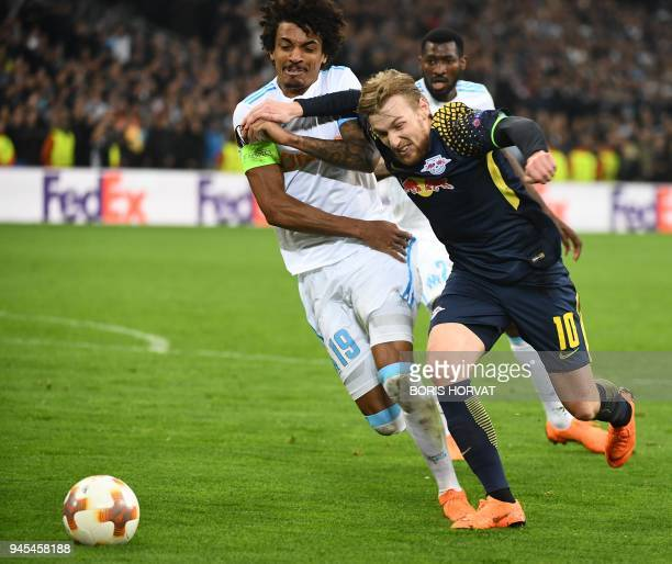 Marseille's Brazilian midfielder Luiz Gustavo vies with Leipzig's Swedish midfielder Emil Forsberg during the Europa League quarter final second leg...