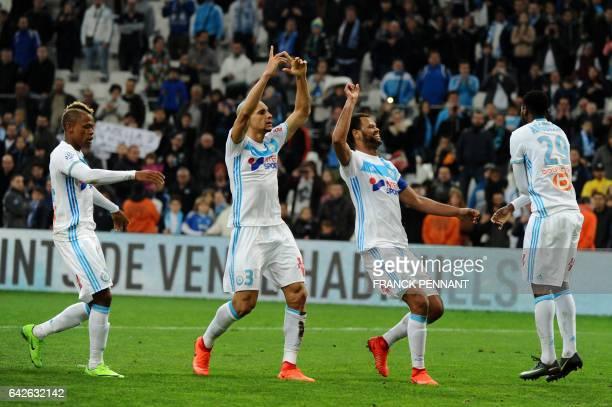 Marseille's Cameroonese forward Clinton Njie Brazilian defender Doria Portuguese defender Rolando and Cameroonese midfielder AndreFrank Zambo...